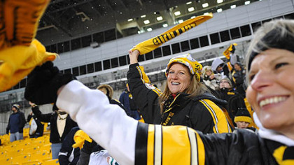 Sandy Gobrish, left, of Ross and BJ Vucelich cheer on the Steelers during a rally for fans.