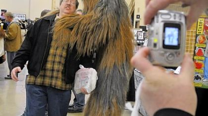 Dan Kellaway of Arnold has his picture taken with Chewbacca by his friend Andrew Gardone at the Pittsburgh Comicon.