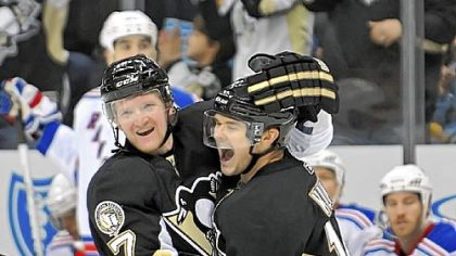 Chris Kunitz celebrates his short-handed goal against the New York Rangers in the third period Sunday at Consol Energy Center.