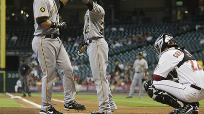 The Pirates&#039; Garrett Jones, left, receives a high five from teammate Andrew McCutchen after hitting a three-run home run in the first inning against the Astros at Minute Maid Park in Houston Thursday.