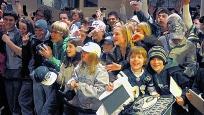 Jets fans cheer for their team in the lobby of the Westin Convention Center hotel, Downtown.