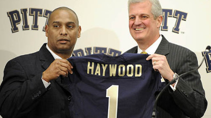 Former Pitt head coach Michael Haywood poses with athletic director Steve Pederson during a press conference Dec. 16. Haywood was fired Jan. 1.