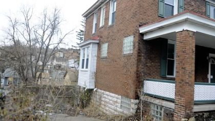 The house next door to Colleen Walters' has been vacant and unmaintained for years.