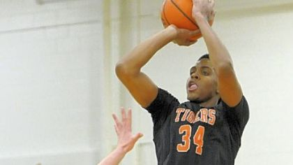 Beaver Falls High School junior Sheldon Jeter puts up a 3-point attempt in a non-section game against rival  Blackhawk earlier this month. Jeter missed the first 11 game with a broken bone in his left hand.
