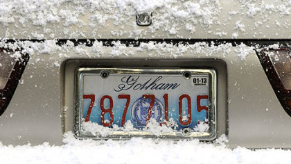 "Snow-covered cars on Oliver Avenue sport Gotham license plates as ""The Dark Knight Rises"" films in Downtown Pittsburgh."