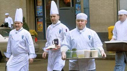 In a familiar sight Downtown, chefs and students from Le Cordon Bleu Institute of Culinary Arts cross Liberty Avenue between their facilities in the Clark Building and those at 808 Liberty.