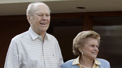 In this April 23, 2006, photo former President Gerald Ford and former first lady Betty Ford smile from the front of their home in Rancho Mirage, Calif.