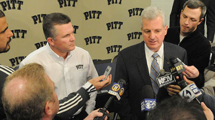 Pitt football head coach Todd Graham, left, and athletic director Steve Pederson talk to media Wednesday.