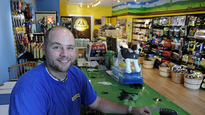 Ben Huber, one of the co-owners of a new pet food store, Petagogy, on Ellsworth Avenue in Shadyside.