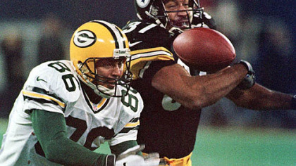 Former Steelers cornerback Carnell Lake deflects a pass intended for the Green Bay Packers' Antonio Freeman in 1998.