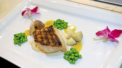 Chilean seabass with roasted cauliflower puree, curried peas and potatoes at Penn Avenue Fish Company.