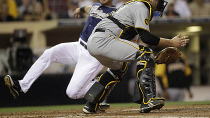Pirates catcher Chris Snyder waits on the late throw as the Padres&#039; Ryan Ludwick slides safely in the third inning Tuesday at Petco Park.