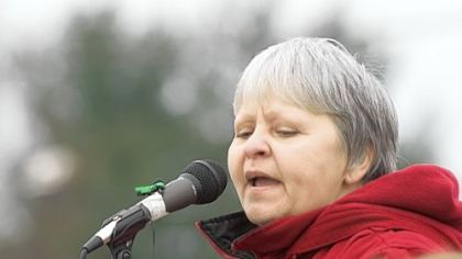 In this 2009 file photo, environmental activist Judy Bonds speaks at Robert Kennedy Jr.'s call for an end to mountaintop removal mining on Coal River Mountain at a rally outside the headquarters of the state Department of Environmental Protection in Charleston, W.Va.