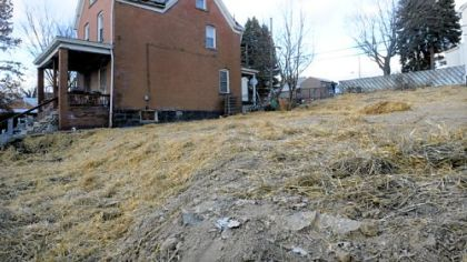 A straw-covered lot is all that remains of a home that was mistakenly demolished along with a scheduled demolition in the 3200 block of Motor Street in Sheraden.