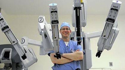 Arthur Thomas, a urologist at St. Clair Hospital, with the $1.8 million robot. The hospital has acquired the robotic device for minimally invasive surgeries.
