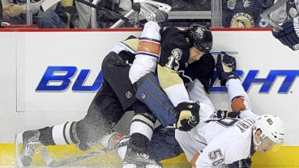 The Penguins&#039; Michael Rupp takes down Edmonton&#039;s Jeff Petry,