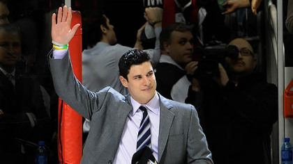 Penguins captain Sidney Crosby waves to the crowd at the team's last home regular season game in April.