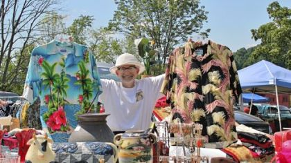 Stephen Razdik showing off his vintage Hawaiian shirts at Tour-Ed Mine Flea Market.