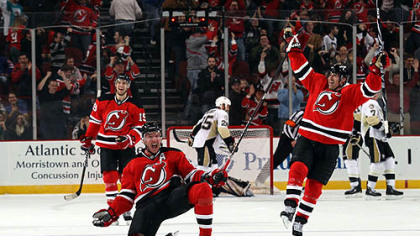 Devils forward Ilya Kovalchuk celebrates his overtime goal against the  Penguins with teammates, Travis Zajac and Brian Rolston at  at the Prudential Center in Newark, N.J. Friday.
