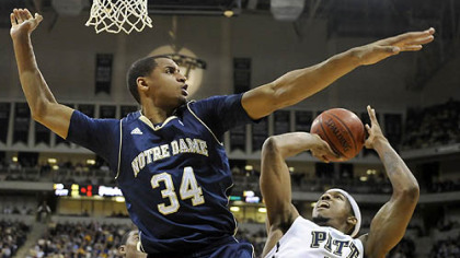 Notre Dame&#039;s Carleton Scott cuts off Gilbert Brown going to the basket Monday night at the Petersen Events Center.