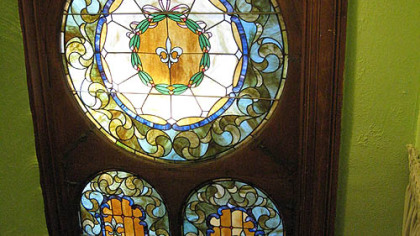 Detail of three stained-glass windows in the landing of the Wigman House in Carrick.