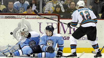 Sharks forward Patrick Marleau scores in overtime on Penguins goaltender Marc-Andre Fleury and defenseman Zbynek Michalek during Wednesday's game at Consol Energy Center.
