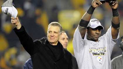 Steelers president Art Rooney II and running back Rashard Mendenhall.
