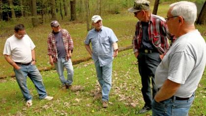 Fred Fletcher, second from right, talks with members of the Sykesville Hunting Club, from left, Larry Righi, Douglas Righi, Tony Zaffuto, and Tom Elkin, about the contamination of the natural spring at the club in Clearfield County. The spring at the hunting lodge in Moshannon State Forest was contaminated by a frac water spill in the summer of 2009.