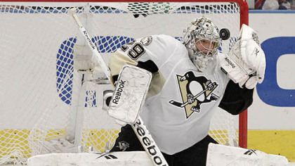 Penguins goaltender Marc-Andre Fleury stops a shot during the third period of Tuesday&#039;s game against the Rangers at Madison Square Garden in New York.