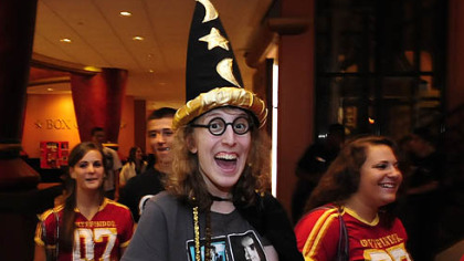"Carly Marnik, 19, of Peters arrives dressed as Harry Potter for the 12:01 screening of the final film of the popular series at AMC Loews Theater at the Waterfront. ""I've been to every midnight opening,"" she said."