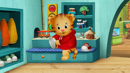 "Daniel Tiger changes into sneakers, a nod to Fred Rogers on ""Mister Rogers' Neighborhood,"" in the new series ""Daniel Tiger's Neighborhood,"" set to debut on PBS stations nationwide in the fall of 2012."
