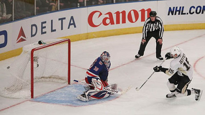 Penguins forward Dustin Jeffrey scores the winning shootout goal against Rangers goaltender Henrik Lundqvist during Tuesday&#039;s game at Madison Square Garden in New York.