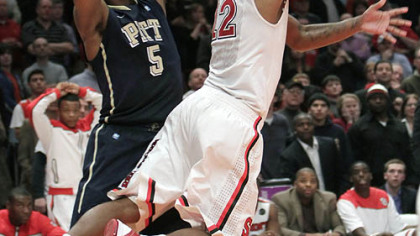 St. John's Dwight Hardy scores the game-winning basket as Pitt's Gilbert Brown defends late in the second half of Saturday's game at Madison Square Garden in New York.