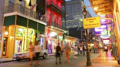 Dusk falls over Bourbon Street in the French Quarter of New Orleans.