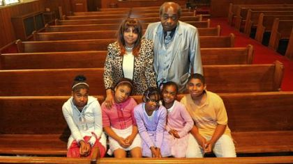 Dorothy Jean Guy and her husband Daniel stand behind their grandchildren, from left, Lisa, Israel, Egypt, Destiny and Jonathan, at their church in Braddock on Sunday. Ms. Guy's grandson Danny is not pictured.