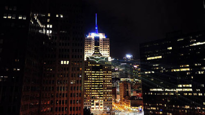 Batman symbol projected on Fifth Avenue Place, Downtown, by Lightwave International Inc., a Pittsburgh-based production company that specializes in laser light shows and special effects for movies and events.