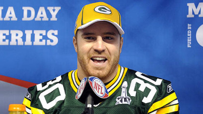 Packers fullback John Kuhn talks to reporters during media day at Cowboys Stadium in Dallas Tuesday.