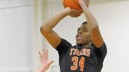 Beaver Falls' Sheldon Jeter puts up a three-point shot against Blackhawk earlier this season.