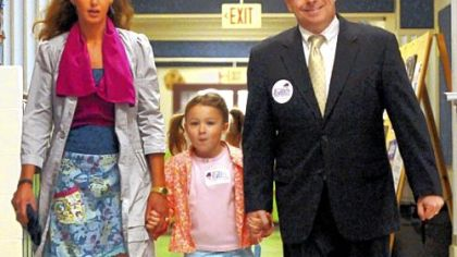 Democratic candidate for Allegheny County Executive Mark Patrick Flaherty is accompanied by his wife, Anne, and daughter, Deirdre, as he arrives to vote at the Markham Elementary School in Mt. Lebanon Tuesday morning. Rich Fitzgerald of Squirrel Hill gained the Democratic nomination in this week's primary.