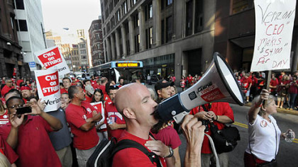 CWA representative Michael Sosak rallies hundreds of striking Verizon workers outside the company's building on Seventh Avenue, Downtown.