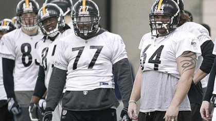 Steelers center Doug Legursky (64), guard Dorian Brooks (77), and other linemen listen to a coach during practice on Friday in Fort Worth, Texas.