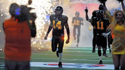 Pittsburgh Power QB Bernard Morris runs onto the field before the opening game in March.