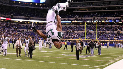 Jets wide receiver Braylon Edwards does a flip in celebration of the Jets&#039; 17-16 win against the Colts during their AFC wild card playoff game at Lucas Oil Stadium Jan. 8, 2011.