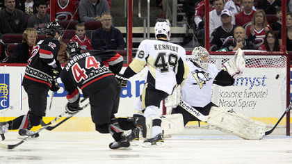 Hurricanes defenseman Jay Harrison fires the puck into the net past Penguins goalie Marc-Andre Fleury during the first period of Friday's game at RBC Center in Raleigh, N.C.