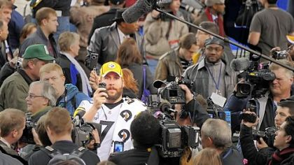Ben Roethlisberger takes time to shoot video of the media gathered before player interviews Tuesday.