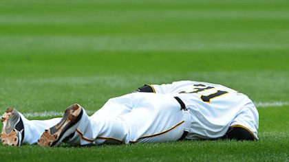 Jose Tabata lies on the field after being injured while beating out a first-inning bunt.