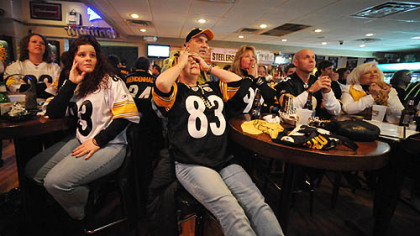 June Hough Repic, of Greenfield, center, covers her eyes while watching with husband Tony and other family members, Lisa Morgavo, Nick Egidlo and Janie Medjimorec at Hough's bar in Greenfield, where Green Bay Packers coach Mike McCarthy was raised.