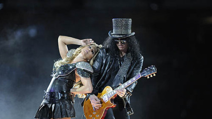 The black-hatted Slash of Guns 'N Roses made a cameo, shown here with Fergie of Black Eyed Peas.