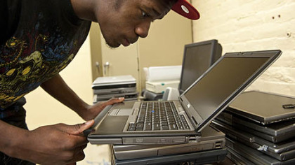 David Dunbar performs the final inspection of a laptop that will be sold by Nonprofit  Technology Resources.