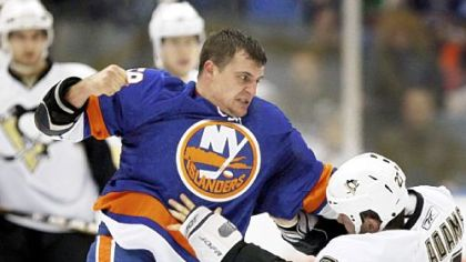 New York Islanders&#039; Micheal Haley, left, and the Penguins&#039; Craig Adams fight in the first period of Friday&#039;s game in Uniondale, N.Y. Both players drew penalties.